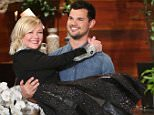 Star of ?Fargo? Kirsten Dunst joins ?The Ellen DeGeneres Show? on Monday, March 14th and gets carried on stage by surprise guest, handosme hunk Taylor Lautner!