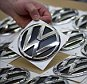 A Volkswagen employee picks up a logo to be fitted on the VW Tiguan and Touran models on March 7, 2012 in Wolfsburg, central Germany. Shares in German auto giant Volkswagen fell more than 13 percent on the Frankfurt stock exchange on September 21, 2015 after it emerged at the weekend that some of its diesel cars in the US had been fitted with software that gave false emissions data.       AFP PHOTO / ODD ANDERSENODD ANDERSEN/AFP/Getty Images