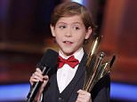 """Jacob Tremblay, of """"Room,"""" holds his award for best actor at the 2016 Canadian Screen Awards in Toronto, Ontario March 13, 2016. REUTERS/Mark Blinch"""
