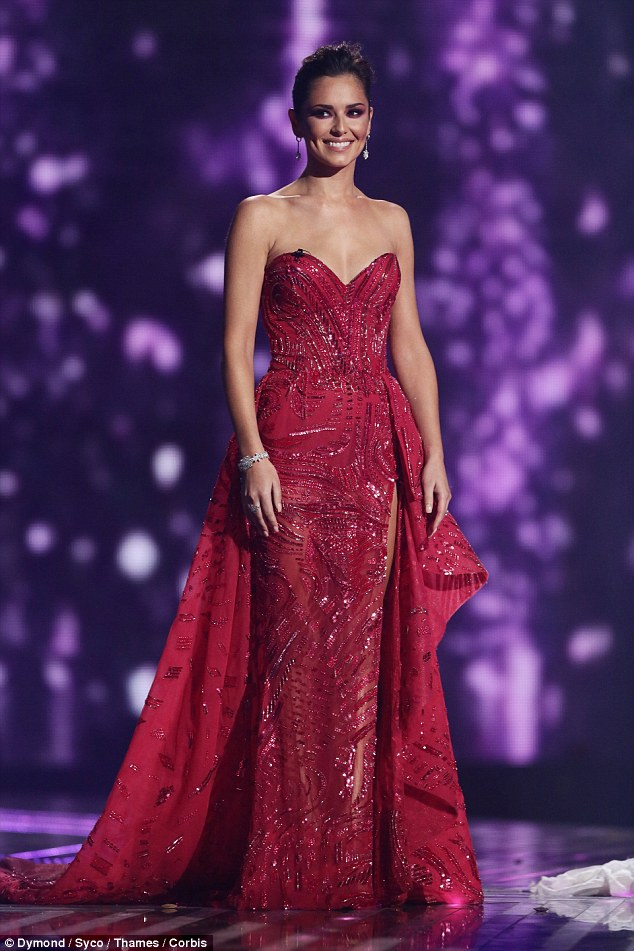 Lady in red: Cheryl Fernandez-Versini looked stunning in a dramatic red Zuhair Murad gown