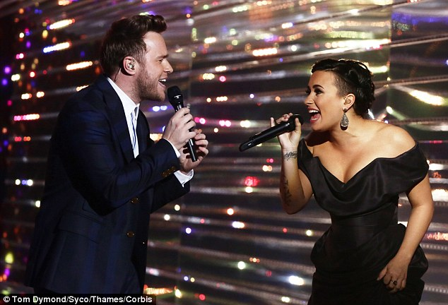 X Factor's UK and US collide: Olly Murs, a previous runner-up on the X Factor UK, duets with former X Factor USA judge Demi Lovato