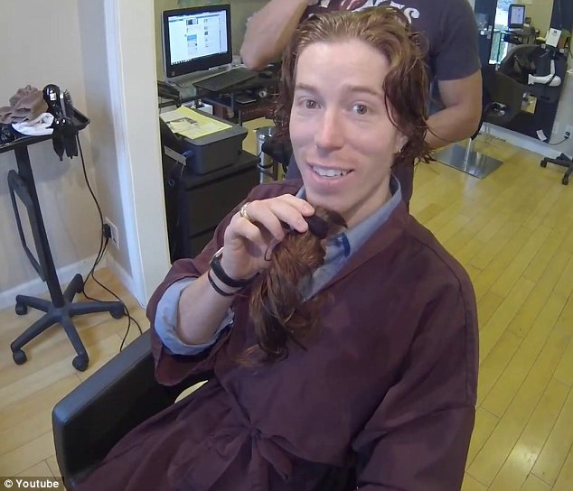 Not such a good look: The 26-year-old joked that he could grow a long beard as he played with his ponytail