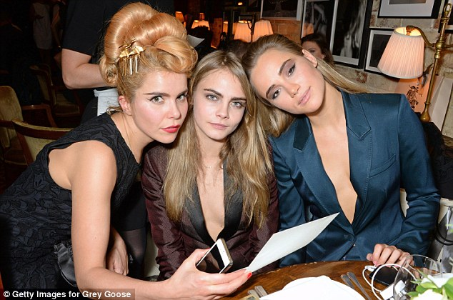 Triple trouble! Paloma, Cara and Suki all seemed to be charging their phones during the event
