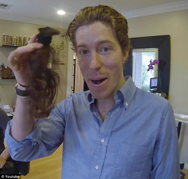 Hair-raising: Shaun White has lopped off his famous red locks that earned him the nickname the Flying Tomato