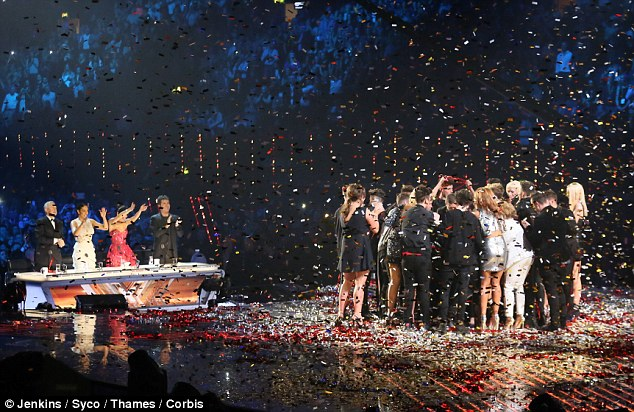 Time to party: The judges join the revelry as they watch the finalists as they're showered with ticker tape