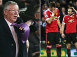 Sir Alex Ferguson of Manchester United stands up with frustration and tries to gesture but his tie gets in the way during the Emirates FA Cup Quarter Final match between Manchester United and West Ham United played at Old Trafford, Manchester on March 13th 2016