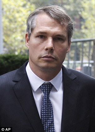 Long face? Shepard Fairey, center, leaves Manhattan Federal court in New York Friday today
