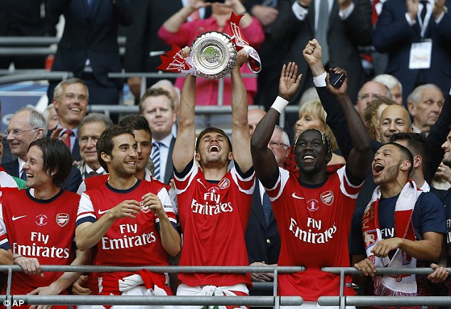 Match winner: Aaron Ramsey (C) lifts the FA Cup that ends Arsenal's nine-year wait for silverware