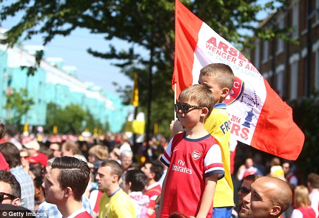 Young Gunns: A pair of children Arsenal fans take in the parade on a sunny Sunday afternoon