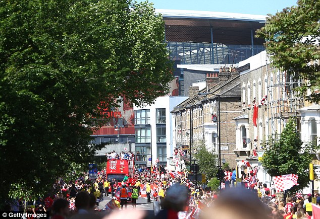 Congestion charge: The open top bus leaves the Emirates in the distances as it travels through north London