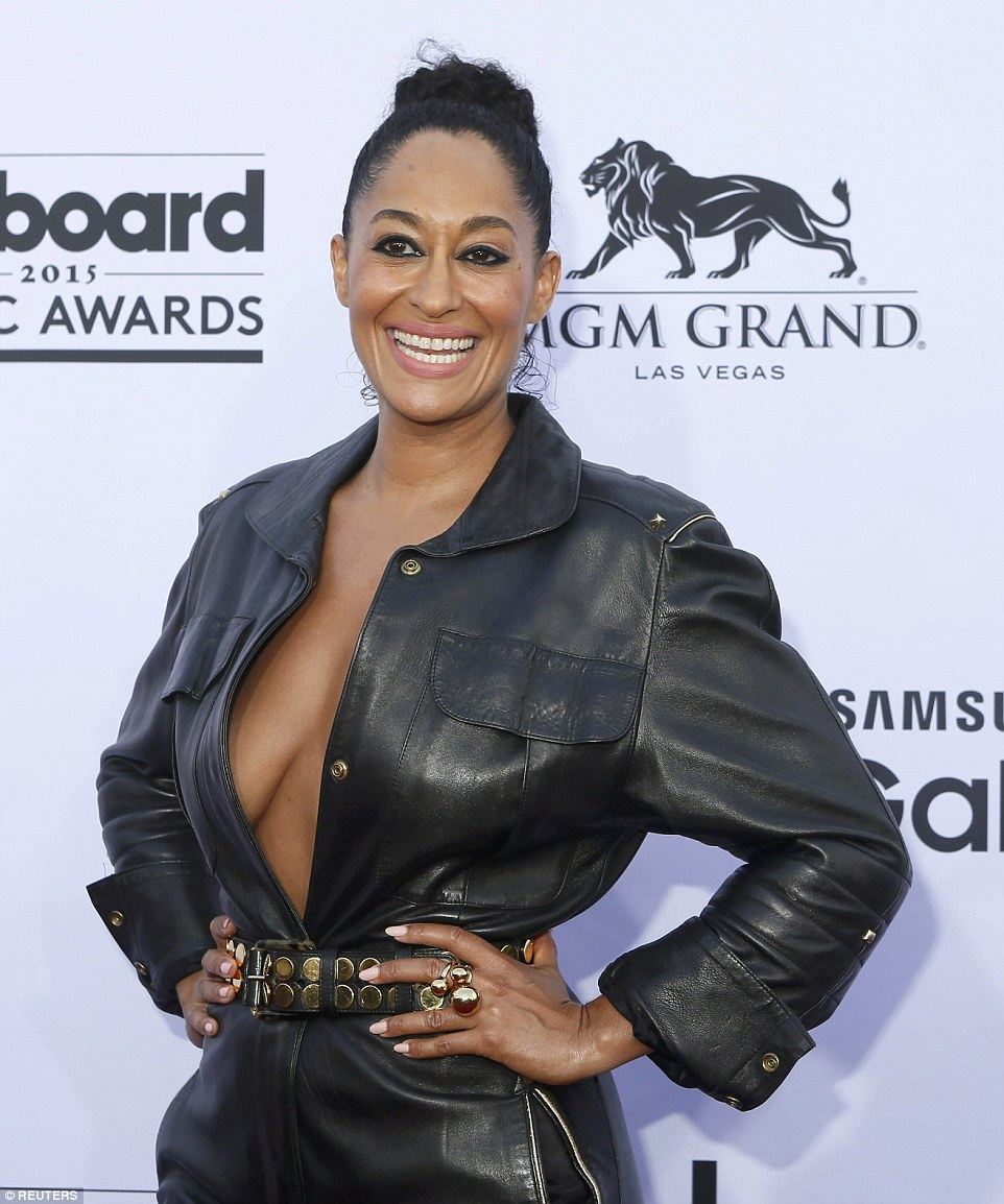 That's an eyeful! Black-ish star Traci Ellis Ross let it all hang out in her belted black leather jumpsuit