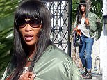 EXCLUSIVE TO INF. March 14, 2016: Naomi Campbell dresses down in floral tunic & jeans, sandals and no make-up as she steps out in Los Angeles, California. The 45-year-old supermodel is back in sunny California after attending the Int'l Women's Day event in Israel early this week, where she was presented with the ìWomen Leading Changeî award for activism. Mandatory Credit: Lazic/Chiva/INFphoto.com Ref: infusla-257/276