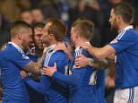 Daryl Murphy of Ipswich Town is surrounded by team-mates after scoring a penalty goal, 1-0,  during the Sky Bet Championship match between Ipswich Town and Blackburn Rovers played at Portman Road, Ipswich on March 15th 2016