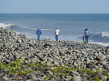 FILE - In this Aug. 10, 2015 photo, municipal workers search Reunion Island beaches where expected debris of the missing Malaysia Airlines Flight 370 could be washed up onto the shore near Saint-Andre, Reunion island. A piece of debris recently found on an Indian Ocean island where a wing fragment from Malaysia Airlines Flight 370 had previously washed ashore is unlikely to be from the missing plane, Australian officials said Wednesday, March 16, 2016. The piece in question was discovered earlier in March, 2016 on French-governed Reunion Island by Johnny Begue, the same man who found a wing fragment on Reunion last year that investigators confirmed was part of the vanished jet. (AP Photo/Fabrice Wislez, File)
