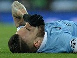 Manchester City's Argentinian defender Nicolas Otamendi (L) reacts as he receives medical treatment before leaving the pitch injured during a UEFA Champions League last 16, second leg football match between Manchester City and Dynamo Kiev at the Etihad Stadium in Manchester, north west England, on March 15, 2016. / AFP PHOTO / OLI SCARFFOLI SCARFF/AFP/Getty Images