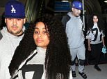 Los Angeles, CA - Former reality star, Rob Kardashian, at LAX returning from a trip in Jamaica with girlfriend, Blac Chyna.  Rob looked slim even in his baggy oversized pullover hoodie, sweatpants, socks, and Givenchy sandals as he walked with Blac Chyna.  She was seen in a jersey, black leggings, and black shoes for her arrival to to Los Angeles.\nAKM-GSI         March 14, 2016\nTo License These Photos, Please Contact :\nSteve Ginsburg\n(310) 505-8447\n(323) 423-9397\nsteve@akmgsi.com\nsales@akmgsi.com\nor\nMaria Buda\n(917) 242-1505\nmbuda@akmgsi.com\nginsburgspalyinc@gmail.com