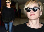 Sharon Stone arrives back at LAX\n\nPictured: Sharon Stone\nRef: SPL1246582  150316  \nPicture by: MONEY$HOT/ Splash News\n\nSplash News and Pictures\nLos Angeles: 310-821-2666\nNew York: 212-619-2666\nLondon: 870-934-2666\nphotodesk@splashnews.com\n