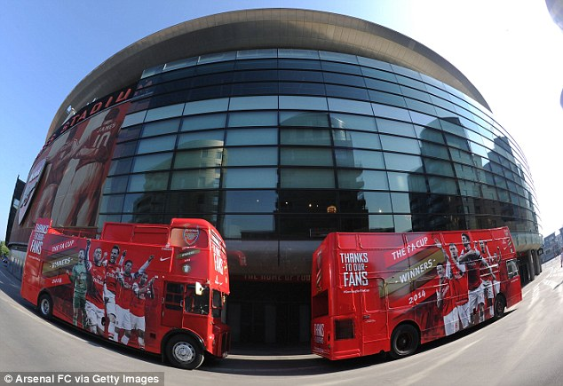 On the buses: Arsenal's FA Cup victory parade starts at the Emirates Stadium and travels through north London