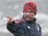 Bayern Munich's Spanish head coach Pep Guardiola gestures during the last team training session one day before the Champions League last 16, second-leg football match between Bayern Munich and Juventus Turin in Munich, southern Germany, on March 15, 2016.  / AFP PHOTO / CHRISTOF STACHECHRISTOF STACHE/AFP/Getty Images