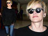 Sharon Stone arrives back at LAX\n\nPictured: Sharon Stone\nRef: SPL1246582  150316  \nPicture by: MONEY$HOT/ Splash News\n\nSplash News and Pictures\nLos Angeles: 310-821-2666\nNew York: 212-619-2666\nLondon: 870-934-2666\nphotodesk@splashnews.com\n