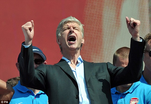 Cutting loose: The normally reserved Arsene Wenger let himself go to get into the spirit of the occassion