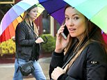EXCLUSIVE TO INF.\nMarch 14, 2016: A make up-less Olivia Wilde beats the rain with a rainbow umbrella today in New York City.\nMandatory Credit: Matthew Nelson/INFphoto.com Ref: infusny-293
