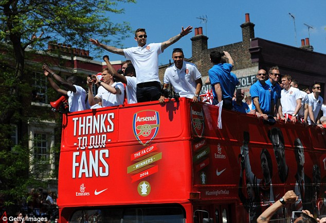 Tottenham baiting: Jack Wilshere (C) to the opportunity to goad Arsenal's north London rivals