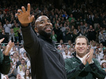 FILE - In this Dec. 21, 2015 file photo, former Michigan State player Mateen Cleaves, left, waves as he is introduced with Michigan State's 2000 national championship team during halftime of Michigan State-Florida NCAA college basketball game in East Lansing, Mich. Cleaves faces charges after a woman says she was held against her will in a motel room and sexually assaulted. Wayne County Prosecutor Kym Worthy says the 39-year-old Cleaves was charged Tuesday March 15, 2016, with criminal sexual conduct, assault with intent to commit criminal sexual penetration and unlawful imprisonment. (AP Photo/Al Goldis, File)