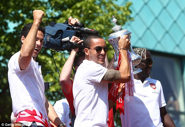 Crock star: Theo Walcott, who missed the final through injury, was at hand to join in the celebrations