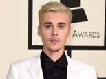 FILE - In this Feb. 15, 2016 file photo, Justin Bieber arrives at the 58th annual Grammy Awards in Los Angeles. An attorney for a photographer who sued Bieber claiming he suffered lasting injuries from a 2012 attack at a shopping plaza in Calabasas, Calif., said Wednesday, March 16, 2016 that the case has been resolved but he could not comment further. (Photo by Jordan Strauss/Invision/AP, FIle)