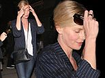 West Hollywood, CA - Charlize Theron is camera shy as she heads to Craig's in West Hollywood. The actress looks cute in a pinstripe blazer and white converse. \nAKM-GSI         March 14, 2016\nTo License These Photos, Please Contact :\nSteve Ginsburg\n(310) 505-8447\n(323) 423-9397\nsteve@akmgsi.com\nsales@akmgsi.com\nor\nMaria Buda\n(917) 242-1505\nmbuda@akmgsi.com\nginsburgspalyinc@gmail.com