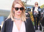 14.March.2016 - West Hollywood Ò USA *** STRICTLY AVAILABLE FOR UK AND GERMANY USE ONLY *** West Hollywood, CA - Rosie Huntington-Whiteley stops by Violet Grey in Weho. The 28-year-old model is wearing black leather leggings and a blush blouse paired with a black coat worn over the shoulders and Givenchy handbag. BYLINE MUST READ : AKM-GSI-XPOSURE ***UK CLIENTS - PICTURES CONTAINING CHILDREN PLEASE PIXELATE FACE PRIOR TO PUBLICATION *** *UK CLIENTS MUST CALL PRIOR TO TV OR ONLINE USAGE PLEASE TELEPHONE 0208 344 2007*