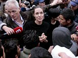 ATHENS, GREECE - MARCH 16: Special envoy of the United Nations High Commissioner for Refugees, Angelina Jolie talks to young migrants during her  visit to the temporary refugee facilities at the port of Piraeus on March 16, 2016 in Athens, Greece. (Photo by Milos Bicanski/Getty Images)