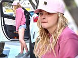 EXCLUSIVE: Chloe Grace Moretz wears no make up and short shorts as she heads to a dermatologist in Beverly Hills. Emma wore a pink sweater and cap as she made her way into a skin doctor. Emma's phone had a small Hilary Clinton sticker on it\n\nPictured: Chloe Grace Moretz\nRef: SPL1247192  150316   EXCLUSIVE\nPicture by: Fern / Bruja / Splash News\n\nSplash News and Pictures\nLos Angeles: 310-821-2666\nNew York: 212-619-2666\nLondon: 870-934-2666\nphotodesk@splashnews.com\n