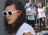 *EXCLUSIVE* Beverly Hills, CA - Harry Styles lunches at Lemonade in the 90210 with his friends. The 1D member is wearing dark skinny jeans and a white tee paired with tan suede boots. Harry sports white framed shades that look like the famous ones Kurt Cobain wore as he walks to the car in the California sun.    AKM-GSI       March 16, 2016 To License These Photos, Please Contact : Steve Ginsburg (310) 505-8447 (323) 423-9397 steve@akmgsi.com sales@akmgsi.com or Maria Buda (917) 242-1505 mbuda@akmgsi.com ginsburgspalyinc@gmail.com