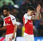 Arsenal players applaud the fans after the UEFA Champions League Round of 16 match between FC Barcelona and Arsenal played at The Camp Nou, Barcelona on March 16th 2016