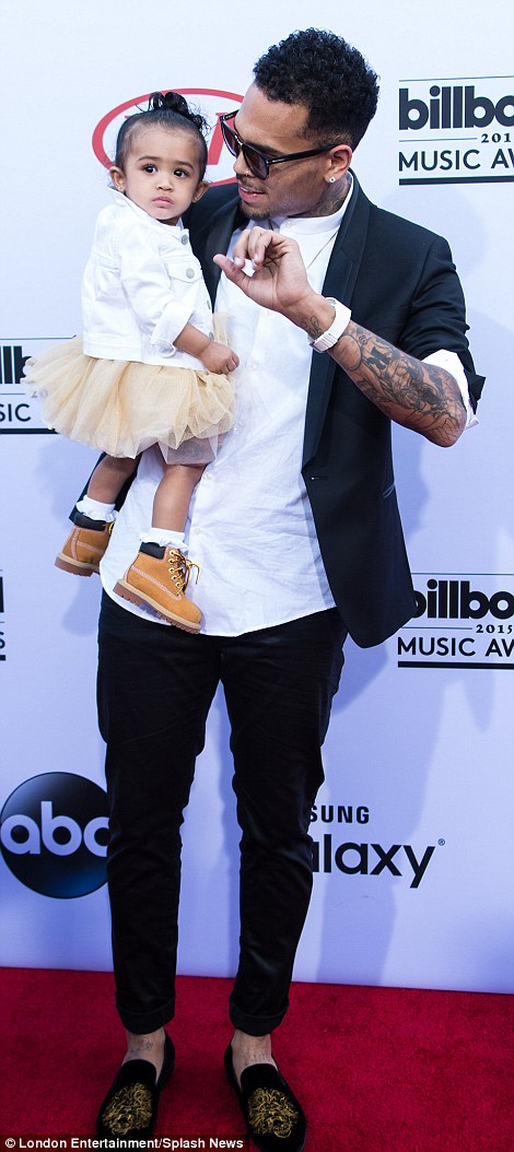 New father: R&B bad-boy Chris Brown gave his daughter Royalty her red carpet debut in a little tutu and Timberland boots
