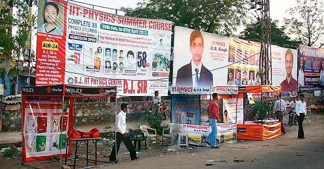 Institutes advertise themselves through banners and kiosks across the town