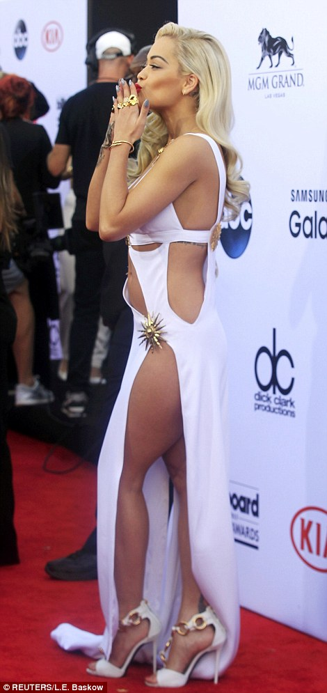 Nearly nude! Black Widow singer Rita Ora certainly gave photographers an eyeful in her white swimsuit-style maxi-dress