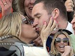 PICTURE - MARK LARGE� 17.03.16 \nKatie Price cheers on during the 3.30pm race, the Ryanair World hurdle Race at Cheltenham on day three, St.Patrick's Day of the Cheltenham Festival 2016 .
