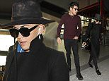 17 March 2016.\nRita Ora makes her way through Heathrow Airport as discreetly as possible, wearing an all black ensemble, with a large black hat, to try and remain incognito. Dressed more like a private detective than a pop star, the singer caught a flight out of England with a handsome male companion\nCredit: Will/GoffPhotos.com   Ref: KGC-305\n