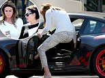 EXCLUSIVE: Caitlyn Jenner has difficulty getting into her $130,000 Porsche GT3 after having a dinner date with friend Ronda Kamihira in Woodland Hills.\n\nPictured: Caitlyn Jenner and  Ronda Kamihira\nRef: SPL1247189  160316   EXCLUSIVE\nPicture by: Clint Brewer / Splash News\n\nSplash News and Pictures\nLos Angeles: 310-821-2666\nNew York: 212-619-2666\nLondon: 870-934-2666\nphotodesk@splashnews.com\n