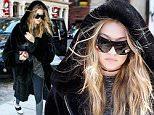 New York, NY - Gigi Hadid tries to be incognito in a giant fur coat after leaving Bar Pitt with friends. The young model looks like she was staying warm in the oversized coat, with an oversized shirt, leggings and sneakers.\n  \nAKM-GSI        March 17, 2016\nTo License These Photos, Please Contact :\nSteve Ginsburg\n(310) 505-8447\n(323) 423-9397\nsteve@akmgsi.com\nsales@akmgsi.com\nor\nMaria Buda\n(917) 242-1505\nmbuda@akmgsi.com\nginsburgspalyinc@gmail.com