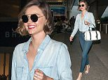 Miranda Kerr smiles and waves to cameras at LAX Airport in Los Angeles. Miranda did not appear to be wearing a bra during her travels.  Pictured: Miranda Kerr Ref: SPL1247933  160316   Picture by: Diabolik / Splash News  Splash News and Pictures Los Angeles: 310-821-2666 New York: 212-619-2666 London: 870-934-2666 photodesk@splashnews.com