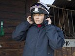 Jockey and former British Olympic cycling champion Victoria Pendleton adjusts her helmet before heading out on the gallops at Lawney Hill Racing in Aston Rowant, southern England March 17, 2016. She is due to ride Pacha Du Polder in the Foxhunter Chase at Cheltenham Festival tomorrow. REUTERS/Eddie Keogh