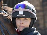 Jockey and former British Olympic cycling champion Victoria Pendleton poses for a photograph with Minella Theatre at Lawney Hill Racing in Aston Rowant, southern England March 17, 2016. She is due to ride Pacha Du Polder in the Foxhunter Chase at Cheltenham Festival tomorrow. REUTERS/Eddie Keogh