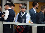 **wearing flat cap footballer Samir Carruthers**\\nPICTURE - MARK LARGEÖ 15.03.16 \\nRace-goers  believed to be professional footballers urinating into glass and then tipping it over the rail of their box at day one of the Cheltenham Festival 2016.