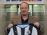 Rafael Benitez poses with a Newcastle United shirt after being confirmed as the club's new manager