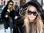 New York, NY - Gigi Hadid tries to be incognito in a giant fur coat after leaving Bar Pitt with friends. The young model looks like she was staying warm in the oversized coat, with an oversized shirt, leggings and sneakers.\n  \nAKM-GSI        March 17, 2016\nTo License These Photos, Please Contact :\nSteve Ginsburg\n(310) 505-8447\n(323) 423-9397\nsteve@akmgsi.com\nsales@akmgsi.com\nor\nMaria Buda\n(917) 242-1505\nmbuda@akmgsi.com\nginsburgspalyinc@gmail.com