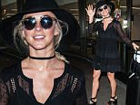 "EXCLUSIVE: Julianne Hough smiles and waves wearing lacy black dress, wide brimmed hat, and tiny ""love"" necklace at LAX Airport in Los Angeles, California.\n\nPictured: Julianne Hough\nRef: SPL1248103  170316   EXCLUSIVE\nPicture by: Diabolik / Splash News\n\nSplash News and Pictures\nLos Angeles: 310-821-2666\nNew York: 212-619-2666\nLondon: 870-934-2666\nphotodesk@splashnews.com\n"